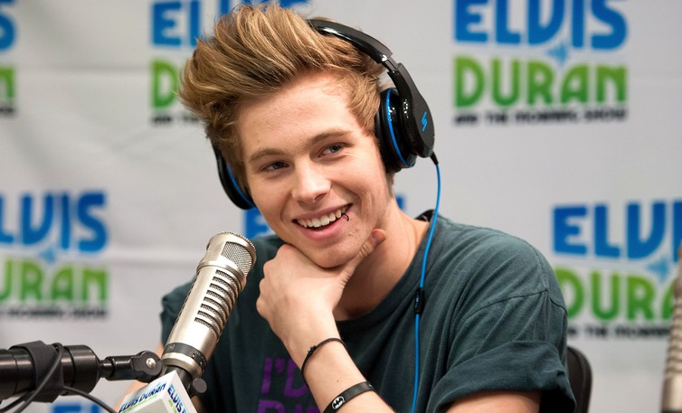 """NEW YORK, NY - APRIL 24:  (EXCLUSIVE COVERAGE) Luke Hemmings of 5 Seconds Of Summer visits The """"Elvis Duran Z100 Morning Show"""" at Z100 Studio on April 24, 2014 in New York City.  (Photo by D Dipasupil/Getty Images)"""