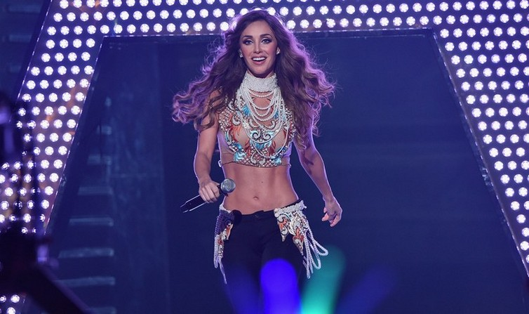 MIAMI, FL - JULY 16:  Anahi performs onstage at Univision's Premios Juventud 2015 at Bank United Center on July 16, 2015 in Miami, Florida.  (Photo by Rodrigo Varela/Getty Images For Univision)