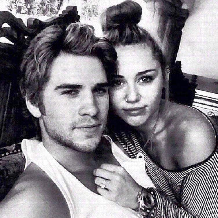 Liam-Hemsworth-Miley-Cyrus-snuggled-up