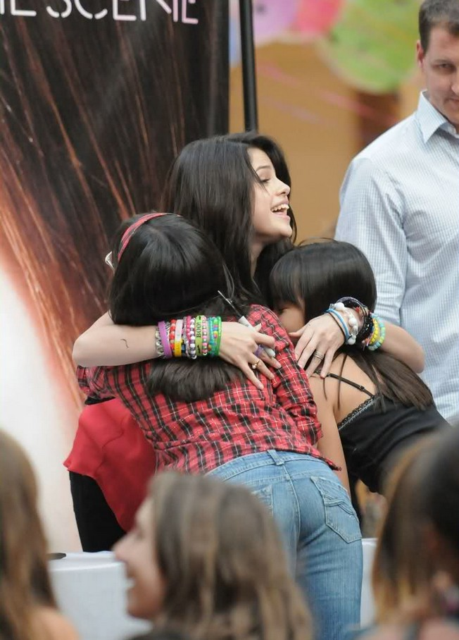 """Costa Mesa, CA - Selena Gomez meets and greets a sea of fans at South Coast Plaza mall to promote her first album """"Kiss & Tell"""" with her band """"The Scene"""". The Disney star is following the footsteps of many previous Disney alumni, adding music to her repertoire like Britney Spears, Christina Aguilara, and Justin Timberlake. The first single off her debut album is """"Falling Down"""", which released on August 21. GSI Media October 3, 2009 (310) 505-8447 (323) 423-9397 (310) 261-8649"""