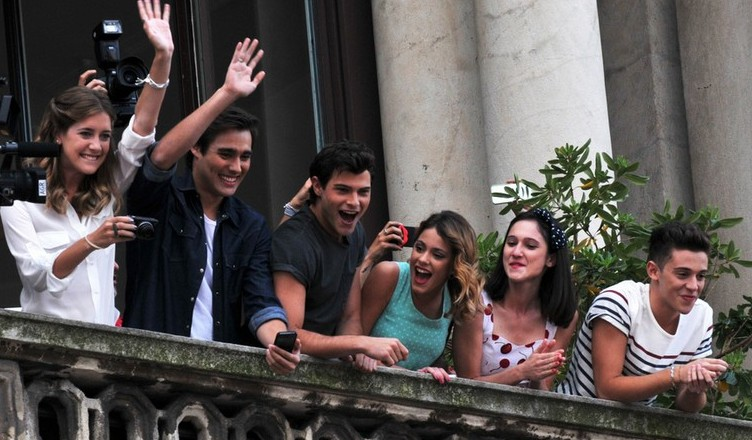 The cast of famous television series, Violetta and E' Grave, seen interacting and greeting their fans from the terrace of Mondadori at Piazza Duomo in Milan