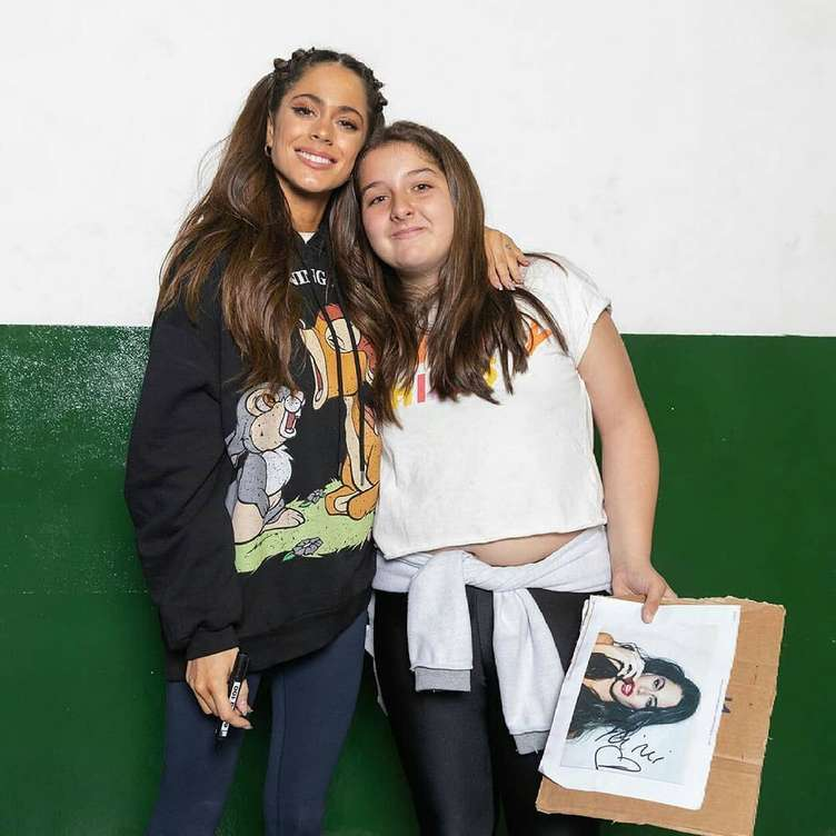 Tini Stoessel posing with a fan after her concert  in Neuquen, Argentina
